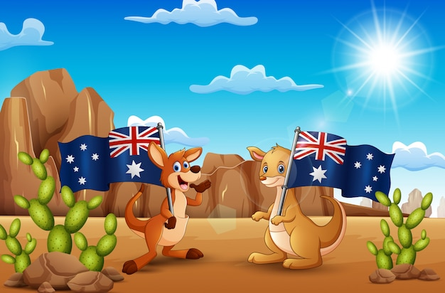 Feliz dia da austrália com cangurus segurando uma bandeira no deserto