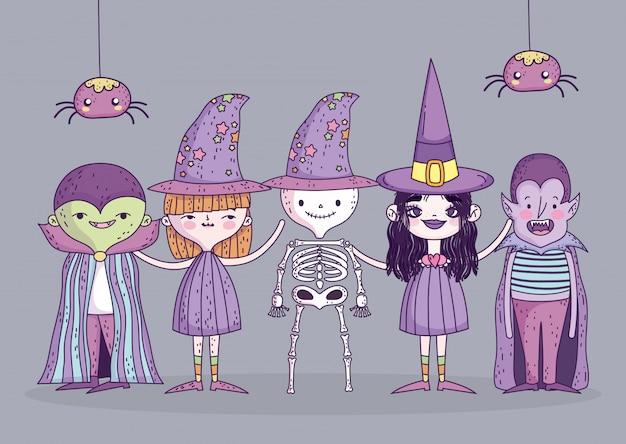 Feliz dia das bruxas celebração meninas e trajes de menino e aranhas