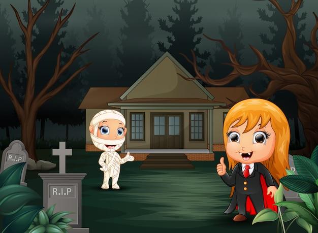 Feliz dia das bruxas com desenhos animados de vampiro e múmia