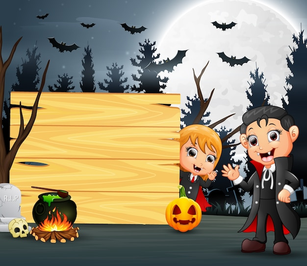 Feliz dia das bruxas com dois vampiro e placa de madeira