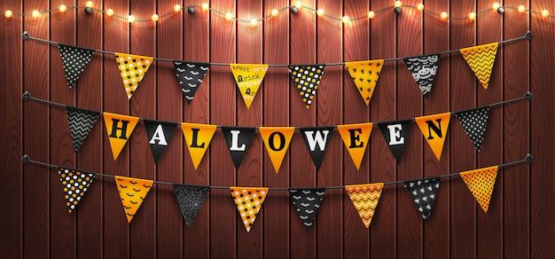Feliz dia das bruxas fundo com luz de seqüência de caracteres e buntings de halloween em fundo madeira