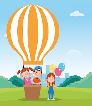 Feliz dia das crianças design com balões de ar quente e crianças felizes dos desenhos animados