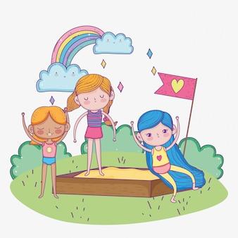 Feliz dia das crianças, meninas brincando no parque infantil de areia ao ar livre