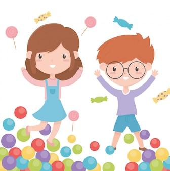 Feliz dia das crianças, sorrindo pequeno menino e menina doces e bolas coloridas vector a ilustração
