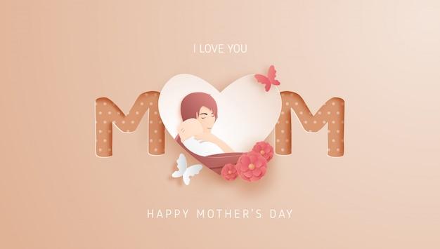 Feliz dia das mães com a mãe abraça seu bebê e estilo de corte de papel e flor.