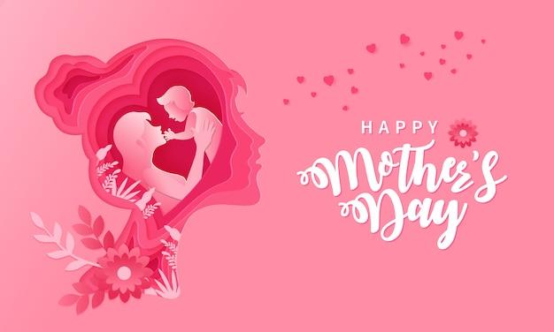 Feliz dia das mães. ilustração de cartão de mãe e bebê dentro de papel cortado silhueta cabeça de mulher