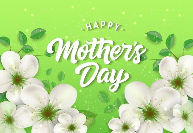 Feliz dia das mães letras com flores brancas sobre fundo verde.