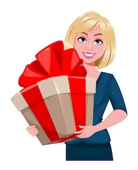 Feliz dia das mães. mulher bonita com uma grande caixa de presente