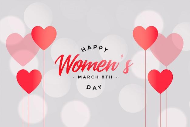 Feliz dia das mulheres corações e bokeh de fundo
