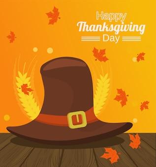 Feliz dia de ação de graças com chapéu de peregrino e espinhos na mesa de madeira.