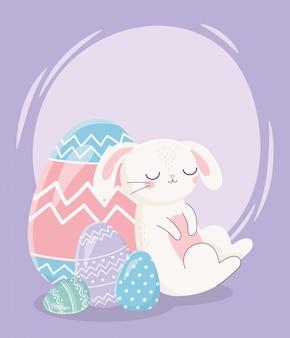 Feliz dia de páscoa, dormindo coelho com decoração de ovos