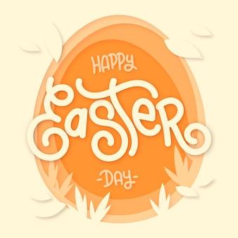 Feliz dia de páscoa em estilo de papel com forma de ovo e folhas