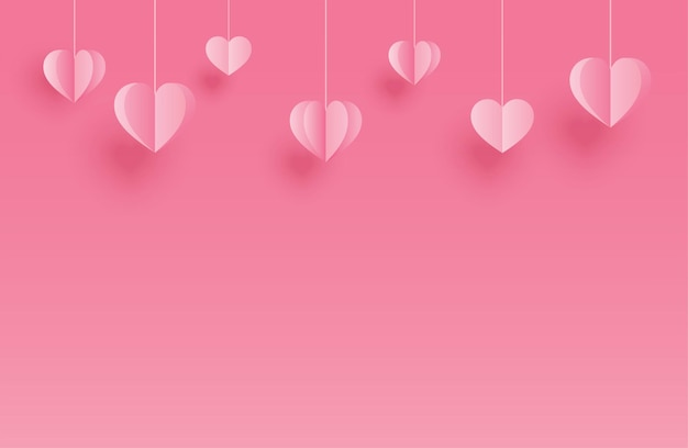 Feliz dia dos namorados cartões com corações de papel pendurados no fundo rosa pastel.
