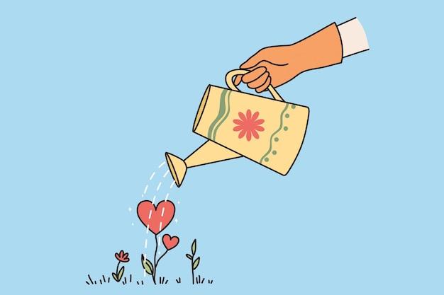 Feliz dia dos namorados e o conceito de amor. mãos humanas regando uma planta em forma de coração vermelho que cresce no chão, cuidando e amando a ilustração vetorial