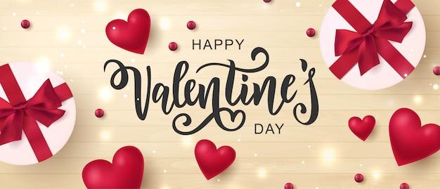 Feliz dia dos namorados mão lettering tipografia com caixas de presente olhando realista e corações