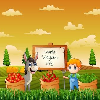 Feliz dia mundial vegano com legumes e fazendeiro na horta