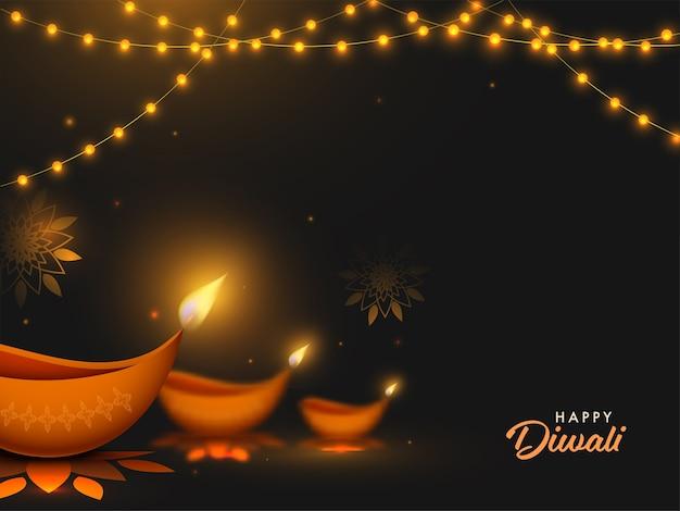 Feliz diwali texto com lâmpadas de óleo iluminadas (diya) e iluminação guirlanda decorada em fundo preto.