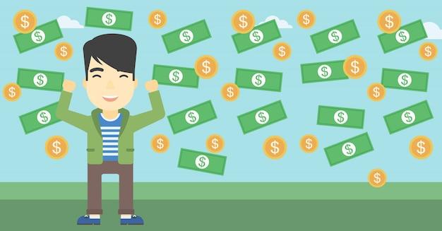 Feliz empresário sob chuva de dinheiro.