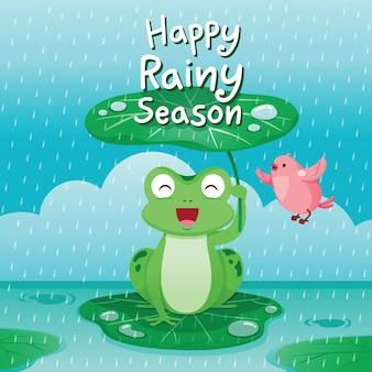 Feliz estação das chuvas, sapo sob a folha de lótus para se proteger na chuva, pássaro voando ao redor