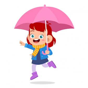 Feliz garoto bonito usar guarda-chuva dia de chuva