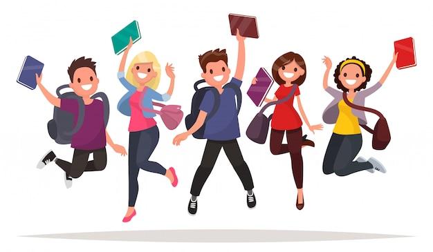 Feliz grupo de estudantes estão saltando sobre um fundo branco. jovens alegres com mochilas e livros.