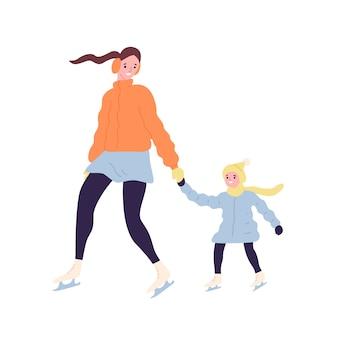 Feliz linda mãe e filha em patins de gelo