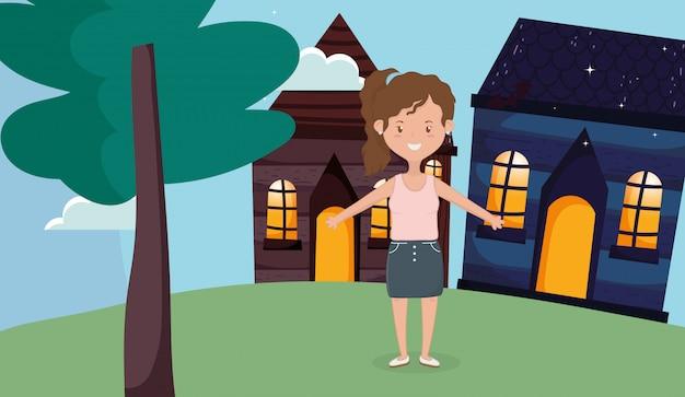 Feliz mulher em pé na frente da casa de campo