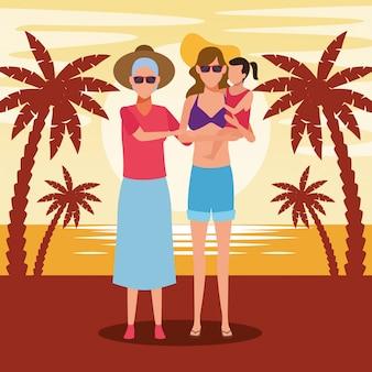 Feliz mulher velha e mulher segurando uma garota na praia