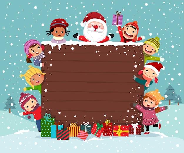 Feliz natal backgroud placa de madeira com grupo de crianças e papai noel