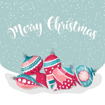 Feliz natal cartão com bolas.