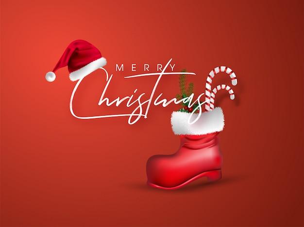 Feliz natal cartão com chapéu de papai noel e bastão de doces, folhas de pinheiro em bota vermelha na laranja.