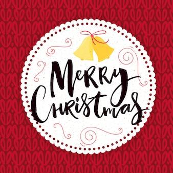 Feliz natal cartão com letras de mão no quadro do círculo na textura vermelha de malha.