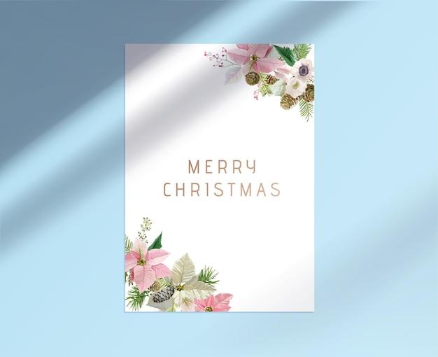 Feliz natal cartão com tipografia, design floral botânico de holly berries e ramos de pinheiro com cones em cantos de folha de papel branco com sombra sobre fundo azul. ilustração vetorial