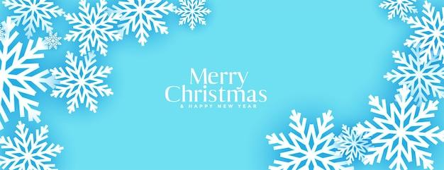 Feliz natal com design de banner 3d de flocos de neve azul