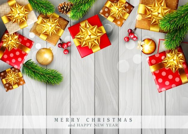 Feliz natal com galhos de decorações e caixas de presente
