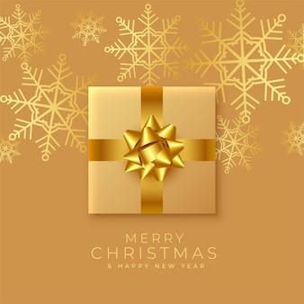 Feliz natal dourado, saudação realista com caixa de presente