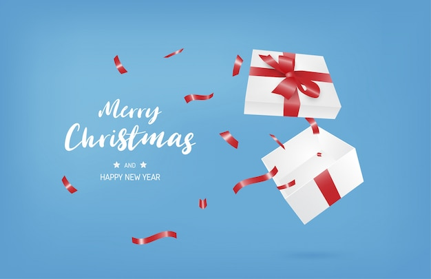 Feliz natal e feliz ano novo banner com caixa de presente aberta sobre fundo azul.