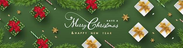 Feliz natal e feliz ano novo banner com objetos festivos realistas