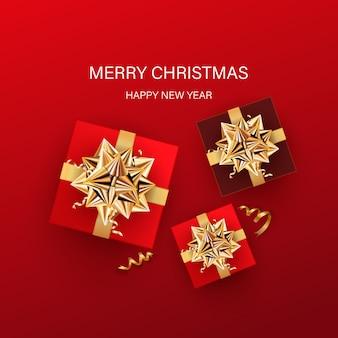 Feliz natal e feliz ano novo cartão com caixas de presente em fundo vermelho