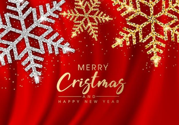 Feliz natal e feliz ano novo cartão com flocos de neve dourados e brilhos