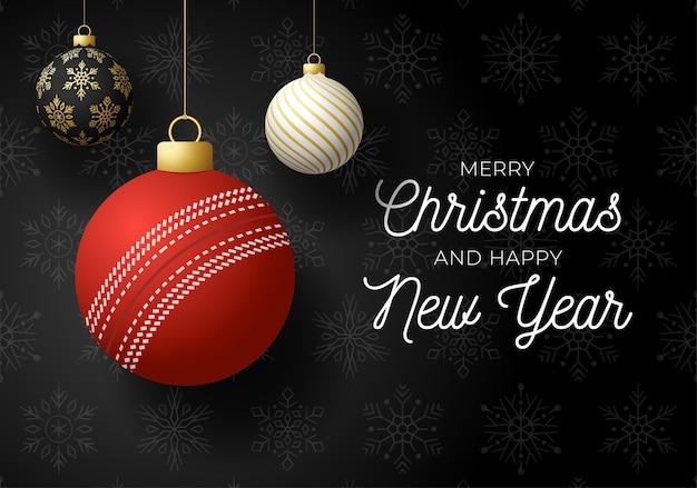 Feliz natal e feliz ano novo cartão de felicitações de esportes de luxo. bola de críquete como uma bola de natal em fundo preto.