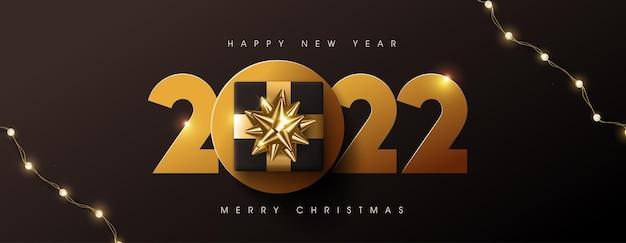 Feliz natal e feliz ano novo de 2022 fundo de design de texto decorado com caixa de presente