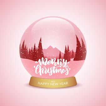 Feliz natal e feliz ano novo. globo de neve com paisagem de montanhas de inverno.
