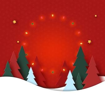 Feliz natal e feliz ano novo paisagem da temporada de inverno árvore de natal decorada com luzes e estrelas arte em papel
