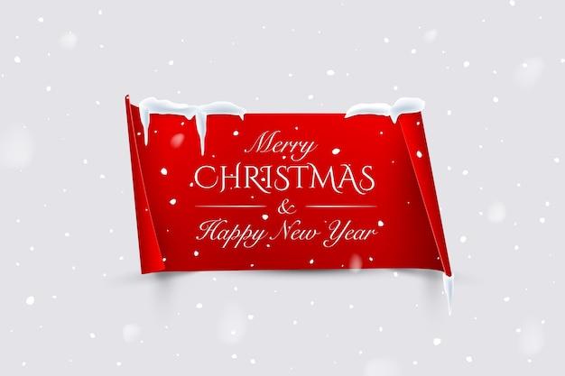 Feliz natal e feliz ano novo texto em papel vermelho com bordas curvas isoladas em fundo de neve.