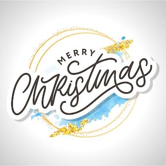 Feliz natal, letras de escova modernas manuscritas com moldura dourada e respingos de aquarela azul