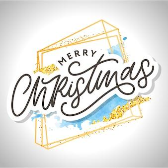 Feliz natal. letras de pincel modernas manuscritas com brilhos de moldura dourada e respingos de aquarela azul