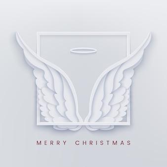Feliz natal papel cortado cartão com asas de anjo branco
