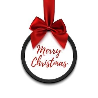Feliz natal preto redondo banner com fita vermelha e arco, isolado no fundo branco. modelo de folheto ou banner.
