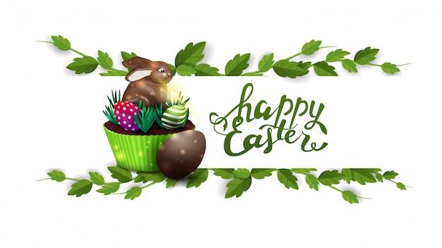 Feliz páscoa, cartão postal branco com moldura de liana e bolo de páscoa
